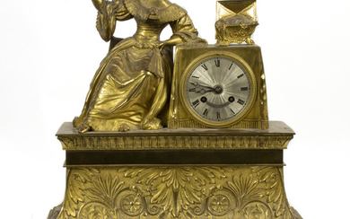 A French gilt bronze statue clock, the seated female examining a necklace