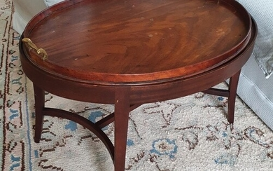 A Georgian Mahogany oval Butlers Table with gallery topped t...