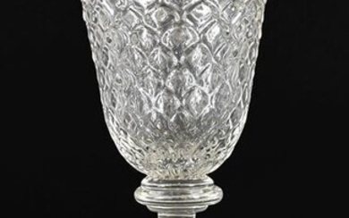 A Glass Goblet, circa 1730, the rounded funnel bowl moulded...