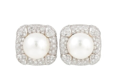 A PAIR OF PEARL AND DIAMOND CLUSTER EARRINGS, the central pe...