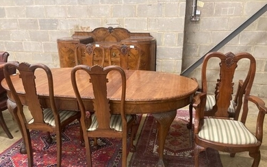 A Queen Anne style figured walnut dining suite comprising ex...