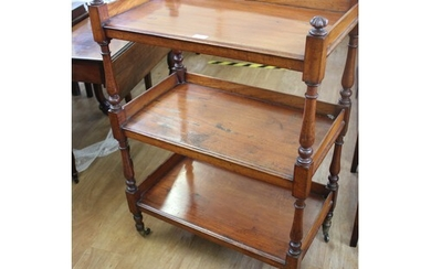 A Victorian mahogany three tier buffet with turned supports,...