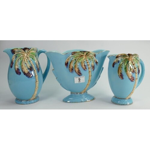 A collection of Beswick light blue Palm vases: and Jugs (3)