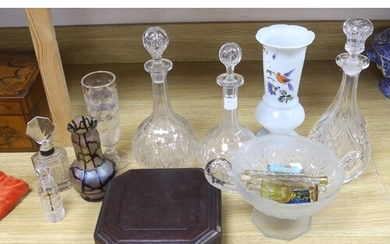 A collection of glass perfume bottles, three decanters, two ...