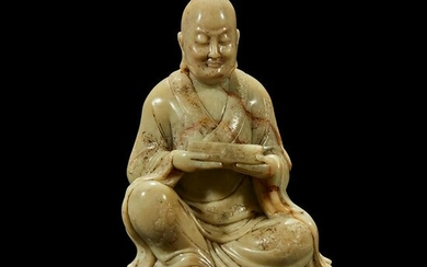 A finely-carved Chinese soapstone figure of a luohan