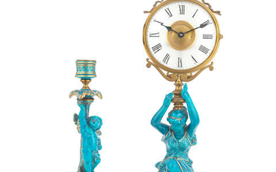 A gilt brass, frosted glass and turquoise glazed ceramic figural mystery time piece together with a similarly glazed figural candlestick