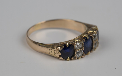 A gold, sapphire and diamond ring, mounted with three oval cut sapphires and two pairs of cushion sh