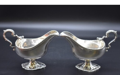 A good pair of George III cast silver sauce boats, by W B (p...
