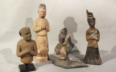 A group of four Chinese painted pottery figures and half figures, perhaps Han Dynasty and later