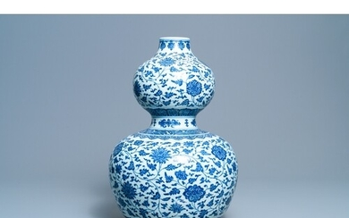 A large Chinese blue and white double gourd vase with floral...