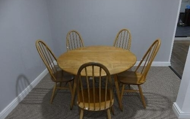 A mid 20thC Ercol elm and beech drop leaf Dining Table, the ...