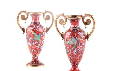 A pair of Russian enamel silver gilt vases, the rims set wit...