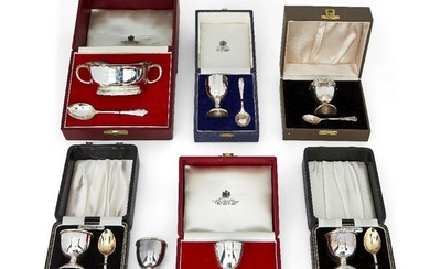 A silver porringer and spoon set retailed by Asprey, Birmingham, c.1973, J B Chatterley & Sons, the porringer with presentation engraving to body, in fitted Asprey & Co. case, together with three cased silver eggcup and spoon sets comprising a...