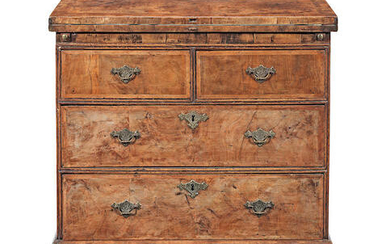 A walnut and featherbanded bachelor's chest