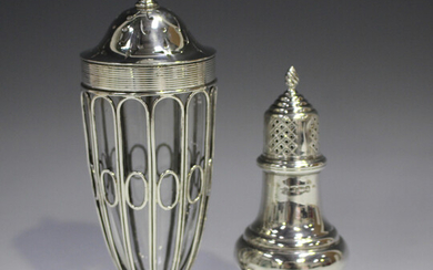 An Edwardian silver sugar caster of elongated ovoid wirework form, with pierced dome cover, on a cir