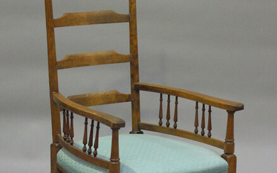 An early 20th century walnut ladder back elbow chair, the seat upholstered in green damask, height 1