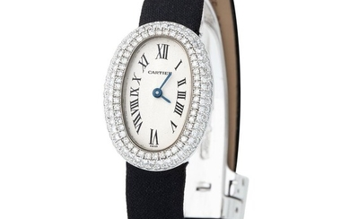 Cartier. Elegant Baignoire Oval Shape Wristwatch in White Gold and Diamonds, With Silver Roman Numbers Dial, box, papers and additional straps