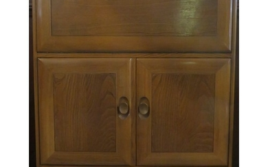 Ercol mid 20th century oak fall front writing cabinet, with ...