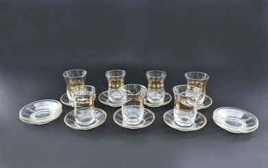 GROUP OF GILT DECORATED GLASS BEAKERS AND SAUCERS