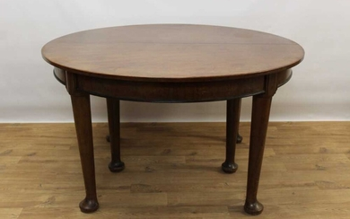Good quality early 20th century mahogany dining table and two leaves on massive bulbous legs.