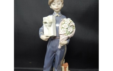 LLADRO Figure of a Bellboy with Chocolates & Flowers: Height...