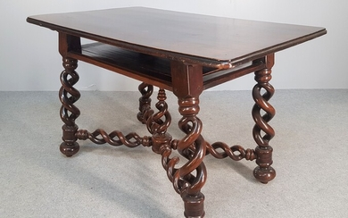 MIDDLE TABLE with a belt top. It rests on a...