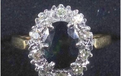 Sapphire and diamond cluster ring, set with an oval sapphire...