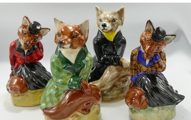 Set of Four Staffordshire Pottery Foxes: all in sample colou...