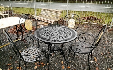 Set of four wrought iron garden chairs and matching table.