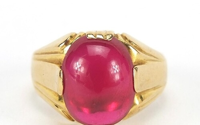 18ct gold cabochon ruby ring, the stone 14mm x 10.5mm x 5.8m...