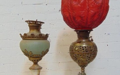 2 oil lamps, figural base with red globe & ceramic &