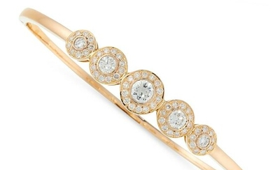 A DIAMOND BANGLE in 18ct yellow gold, set with a row of