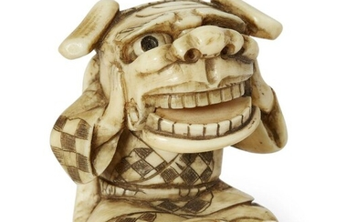 A Japanese ivory netsuke, 19th century, carved as a Chinese boy with lion mask, signed Hirozan to base, 4cm