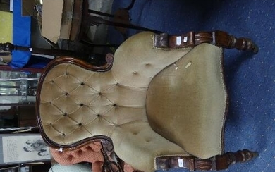 A Victorian walnut upholstered Armchair, the spoon back with...