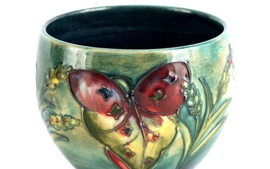 A WALTER MOORCROFT SQUAT FOOTED VASE tube lined an