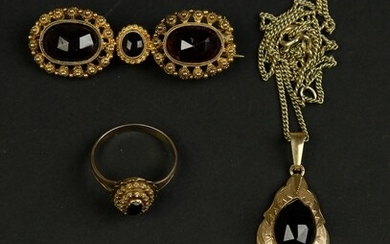 A collection of garnet jewellery: a 14k ring, brooche and...