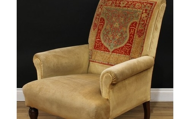 A late Victorian 'carpet' armchair, scroll arms, stuffed-ove...