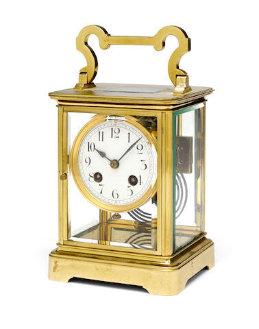 An large early 20th century brass four-glass corniche carriage clock