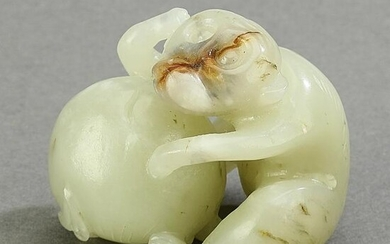 Chinese jade carving of a monkey and peach