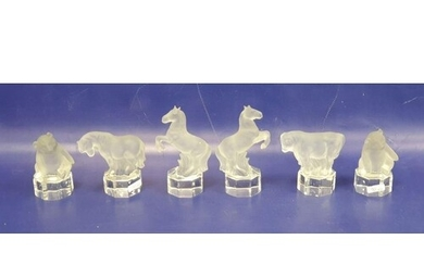 Six glass models of animals, each frosted with clear glass b...