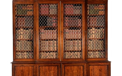 Y A REGENCY ROSEWOOD AND BRASS MOUNTED BREAKFRONT LIBRARY BOOKCASE, CIRCA 1815