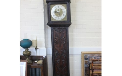 A 19th century carved oak longcase clock, the eight-day move...