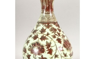A CHINESE IRON RED BULBOUS VASE, decorated with floral patte...