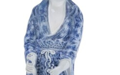 A CHINESE WHITE AND BLUE PORCELAIN SCULPTURE OF GUANYIN. 20TH CENTURY.