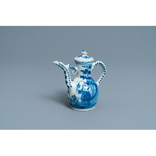 A Dutch Delft blue and white chinoiserie wine ewer and cover...