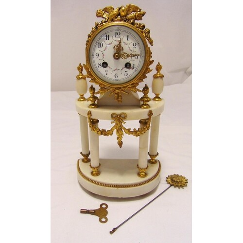 A French gilt metal and white marble clock, two train moveme...