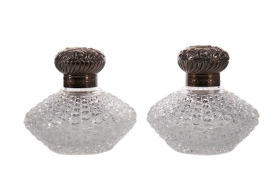 A PAIR OF VICTORIAN SILVER MOUNTED CUT GLASS SCENT BOTTLES