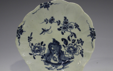 A Worcester porcelain shell shaped pickle dish, circa 1770, painted in blue with the Two Peony Rock