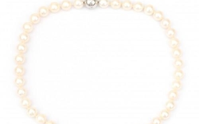 A cultured pearl necklace to a 14 karat white gold diamond clasp. Gross weight: 64 g.
