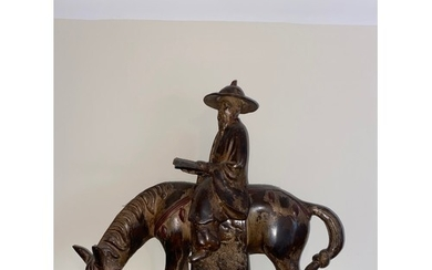 A heavy Chinese figure, of a scholar on horseback, the schol...